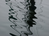 Abstract View of the Reflections of Pilings on Water Photographic Print by Todd Gipstein