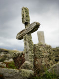 An Old Moss-Covered Cross Stands Amid Rocks in a Graveyard Photographic Print by Jim Richardson