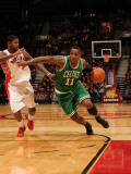 Boston Celtics v Toronto Raptors: Glen Davis and Amir Johnson Photographic Print by Ron Turenne