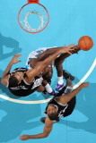 San Antonio Spurs v New Orleans Hornets: Emeka Okafor and Tim Duncan Photographic Print by Chris Graythen