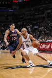 Atlanta Hawks v San Antonio Spurs: Tony Parker and Mike Bibby Photographic Print by D. Clarke Evans