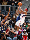 Indiana Pacers v Atlanta Hawks: Jeff Teague and T.J. Ford Photographic Print by Kevin Cox