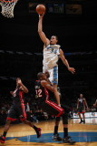Miami Heat v Washington Wizards: JaVale McGee and James Jones Photographic Print by Ned Dishman