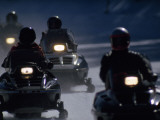 Snowmobilers Ride Down a Snowy Road in Yellowstone Park Impresso fotogrfica por Raymond Gehman