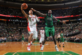 Toronto Raptors v Boston Celtics: Jerryd Bayless and Kevin Garnett Photographic Print by Brian Babineau
