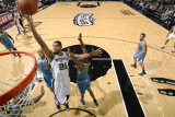New Orleans Hornets v San Antonio Spurs: Tim Duncan and Trevor Ariza Photographic Print by D. Clarke Evans