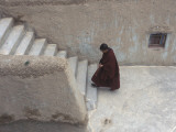 A Tibetan Nun Climbs a Staircase Photographic Print by Alison Wright