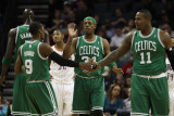 Boston Celtics v Charlotte Bobcats: Paul Pierce, Rajon Rondo and Glen Davis Photographic Print by  Streeter