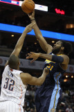 Denver Nuggets v Charlotte Bobcats: Nene and Boris Diaw Photographic Print by Streeter
