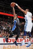 Orlando Magic v Denver Nuggets: Jameer Nelson and Shelden Williams Photographic Print by Garrett Ellwood