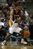 Los Angeles Lakers v Milwaukee Bucks: Earl Boykins and Pau Gasol Photographic Print by Jonathan Daniel