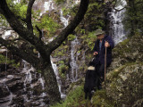 A Shepherd Speaks to His Dog by a Waterfall Photographic Print by Jim Richardson