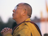 The Dalai Lama Prays During a Ceremony Photographic Print by Alison Wright