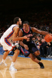 Atlanta Hawks v New York Knicks: Joe Johnson and Landry Fields Photographic Print by Jeyhoun Allebaugh