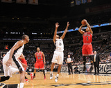 Chicago Bulls v San Antonio Spurs: Derrick Rose and Tony Parker Photographic Print by D. Clarke Evans