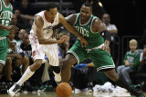 Boston Celtics v Charlotte Bobcats: Glen Davis and Shaun Livingston Photographic Print by  Streeter