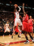 Houston Rockets v Toronto Raptors: Sonny Weems and Jordan Hill Photographic Print by Ron Turenne