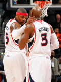 Indiana Pacers v Atlanta Hawks: Josh Smith and Damien Wilkins Photographic Print by Kevin Cox
