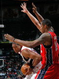 New Jersey Nets v Atlanta Hawks: Al Horford and Derrick Favors Photographic Print by Kevin Cox