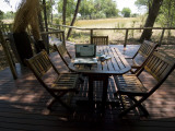 A Laptop Computer on a Table in Okavango&#39;s Chitabe Camp Photographic Print by Jodi Cobb