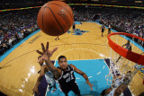 San Antonio Spurs v New Orleans Hornets: Tim Duncan and David West Photographic Print by Chris Graythen