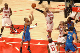 Oklahoma City Thunder v Chicago Bulls: Taj Gibson and Eric Maynor Photographic Print by Joe Murphy