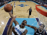 San Antonio Spurs v New Orleans Hornets: Trevor Ariza and Tim Duncan Photographic Print by Layne Murdoch