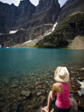 A Girl Wearing a Cowboy Hat Enjoys Iceberg Lake in Montana Photographic Print by Michael Hanson