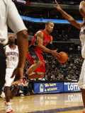 Toronto Raptors v Charlotte Bobcats: Jerryd Bayless Photographic Print by Kent Smith