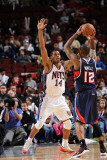 Atlanta Hawks v New Jersey Nets: Josh Powell and Derrick Favors Photographic Print by David Dow