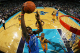 Oklahoma City Thunder v New Orleans Hornets: Serge Ibaka and Jarrett Jack Photographic Print by  Chris