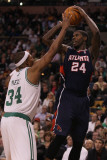 Atlanta Hawks v Boston Celtics: Marvin Williams and Paul Pierce Photographic Print by  Elsa