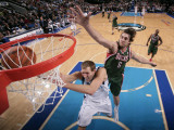 Milwaukee Bucks v Dallas Mavericks: Dirk Nowitzki and Andrew Bogut Photographic Print by Glenn James
