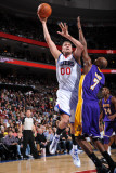 Los Angeles Lakers v Philadelphia 76ers: Spencer Hawes and Lamar Odom Photographic Print by Jesse D. Garrabrant