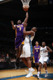 Los Angeles Lakers v Washington Wizards: Lamar Odom and Kevin Seraphin Photographic Print by Ned Dishman
