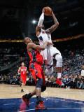 New Jersey Nets v Atlanta Hawks: Derrick Favors and Josh Smith Photographic Print by Kevin Cox