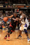 Miami Heat v Sacramento Kings: Dwayne Wade and Tyreke Evans Photographic Print by Ezra Shaw