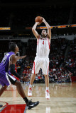 Sacramento Kings v Houston Rockets: Luis Scola and Jason Thompson Photographic Print by Bill Baptist