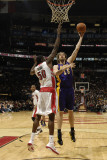 Los Angeles Lakers v Toronto Raptors: Pau Gasol and Solomon Alabi Photographic Print by Ron Turenne