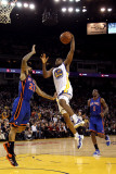 New York Knicks v Golden State Warriors: Reggie Williams and Wilson Chandler Photographic Print by Ezra Shaw