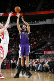 Sacramento Kings v Houston Rockets: Omri Casspi and Chase Budinger Photographic Print by Bill Baptist