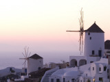 Stuccoed Houses and Windmills on a Hillside at Twilight Photographic Print by Richard Nowitz