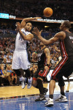 Miami Heat v Orlando Magic: Jameer Nelson and Chris Bosh Photographic Print by Mike Ehrmann