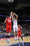 Philadelphia 76ers v New Jersey Nets: Brook Lopez and Spencer Hawes Photographic Print by  David