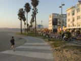 A Jogger on a Bike Path Along Venice Beach Papier Photo par Rich Reid