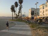 A Jogger on a Bike Path Along Venice Beach Photographic Print by Rich Reid