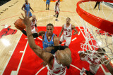 Oklahoma City Thunder v Chicago Bulls: Russell Westbrook and Taj Gibson Photographic Print by Joe Murphy