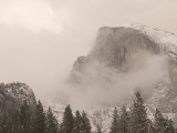 Half Dome Stands Amid the Clouds in Yosemite Valley in Winter Photographic Print by Phil Schermeister