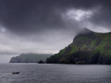 A Zodiac Explores the Scenic Hebrides Islands on a Cloudy Day Photographic Print by Jim Richardson