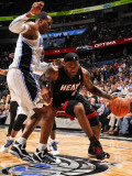 Miami Heat v Orlando Magic: LeBron James and Dwight Howard Photographic Print by Fernando Medina